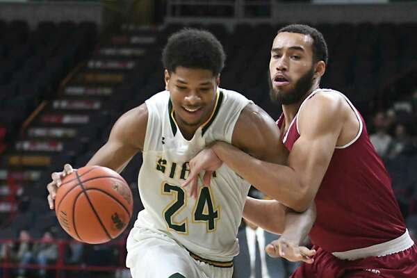 Siena's Lavon Long, left, is defended by Rider's Xavier Lundy during a basketball game at the Times Union Center on Tuesday, Jan. 17, 2017 in Albany, N.Y. (Lori Van Buren / Times Union)