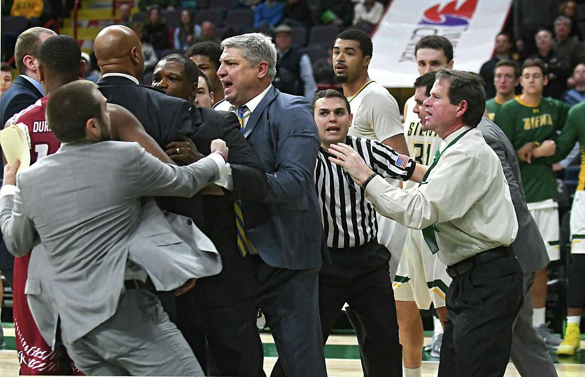 Referees and coaches try to hold back head coaches Kevin Baggett of Rider and Jimmy Patsos of Siena during a fight that broke out during a basketball game at the Times Union Center on Tuesday, Jan. 17, 2017 in Albany, N.Y. (Lori Van Buren / Times Union)
