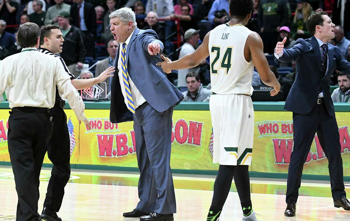 Siena Head Coach Jimmy Patsos, center, yells at a referee after a fight broke out during a basketball game against Rider at the Times Union Center on Tuesday, Jan. 17, 2017 in Albany, N.Y. (Lori Van Buren / Times Union)