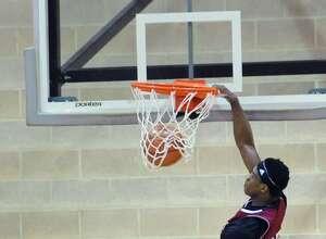 St. Luke's Walter Whyte dunks at Brunswick on Thursday.