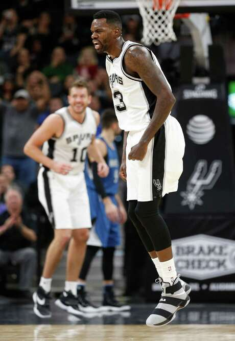 Spurs' Dewayne Dedmon (03) reacts after a score against the Minnesota Timberwolves during their game at the AT&T Center on Tuesday, Jan. 17, 2017. Spurs defeated the Timberwolves, 122-114. Photo: Kin Man Hui, San Antonio Express-News / ©2017 San Antonio Express-News