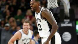 Spurs' Dewayne Dedmon (03) reacts after a score against the Minnesota Timberwolves during their game at the AT&T Center on Tuesday, Jan. 17, 2017. Spurs defeated the Timberwolves, 122-114.