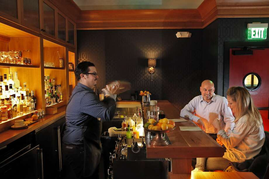 Bar manager Drew Majoulet (left) makes cocktails for John Orta and Annie Happel at the Linden Room in S.F. Photo: Carlos Avila Gonzalez, The Chronicle