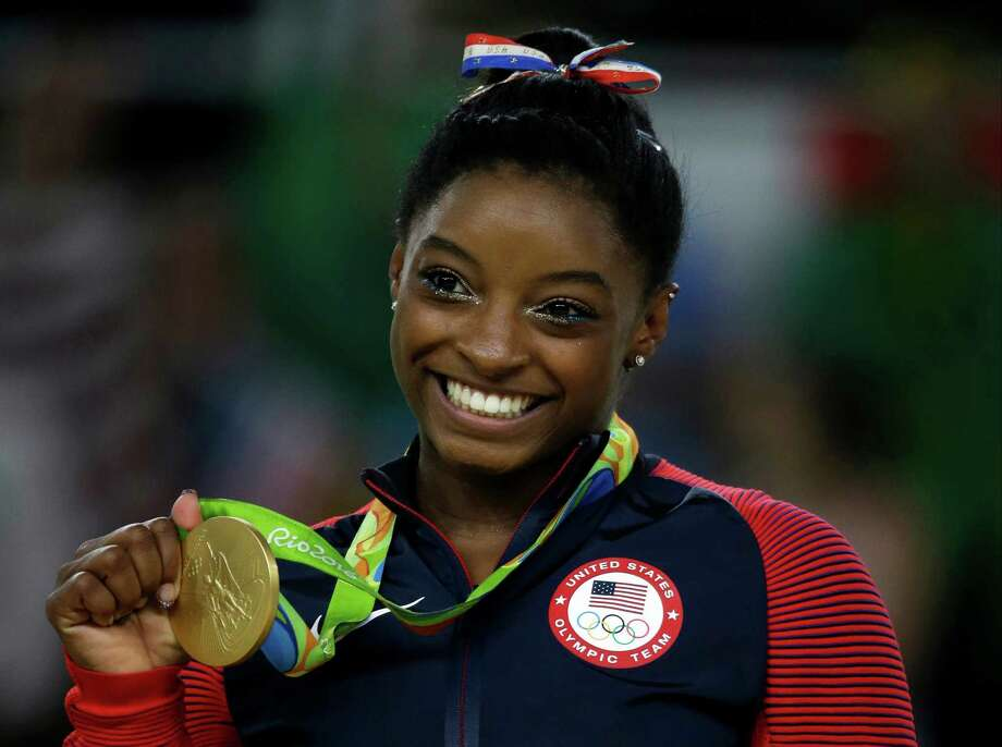 Simone Biles - The spring resident already had 10 World Championship gold medals before she dominated the 2016 Olympics in Brazil. There, the 20-year old won the individual all-around gold medal and helped the United States win gold in the team event. Her success has netted her, among other things, an spot on Dancing With The Stars. Photo: Rebecca Blackwell, STF / Copyright 2016 The Associated Press. All rights reserved. This material may not be published, broadcast, rewritten or redistribu
