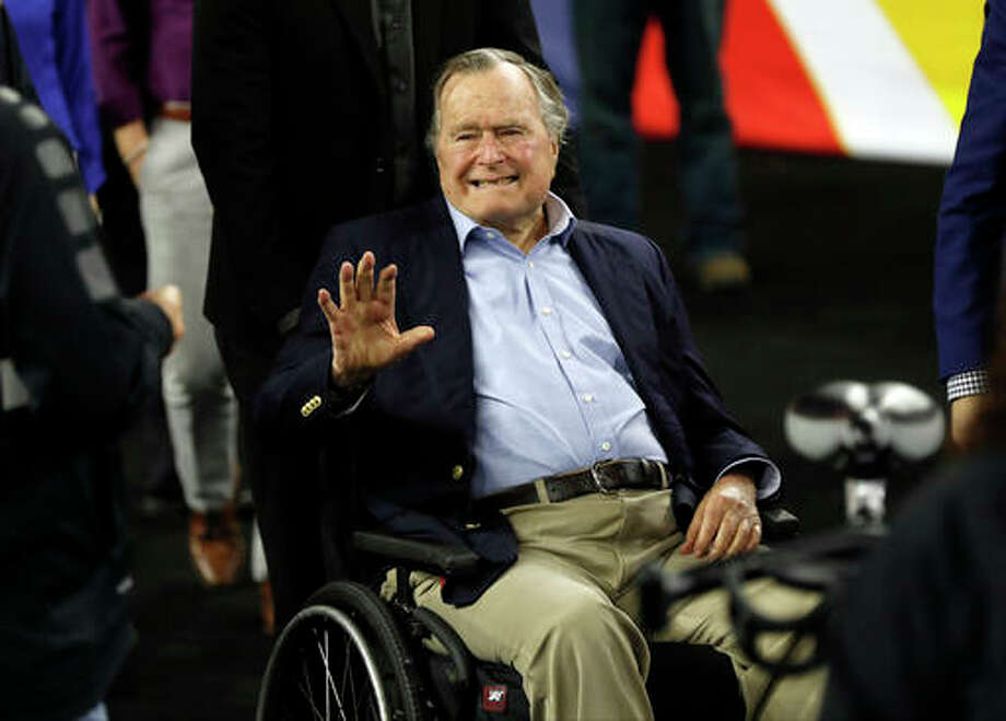 In this April 2 file photo, former President George H. W. Bush waves as he arrives at NRG Stadium before the NCAA Final Four tournament college basketball semifinal game between Villanova and Oklahoma in Houston. Houston-area media are quoting former President George H.W. Bush's chief of staff as saying that Bush has been hospitalized in Houston. Photo: Associated Press / Copyright 2016 The Associated Press. All rights reserved.