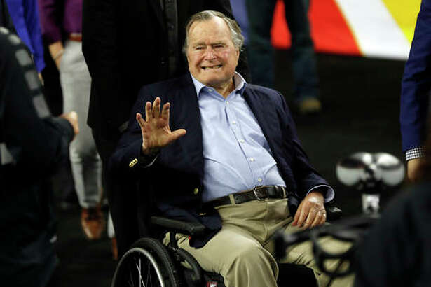 In this April 2 file photo, former President George H. W. Bush waves as he arrives at NRG Stadium before the NCAA Final Four tournament college basketball semifinal game between Villanova and Oklahoma in Houston. Houston-area media are quoting former President George H.W. Bush's chief of staff as saying that Bush has been hospitalized in Houston.