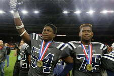 West Orange-Stark's Te'Ron Brown left, and Ledarian Carter react after West Orange-Stark defeated Celina in the 4A Division II State Championship game at NRG Stadium Friday, Dec. 18, 2015, in Houston. ( James Nielsen / Houston Chronicle )