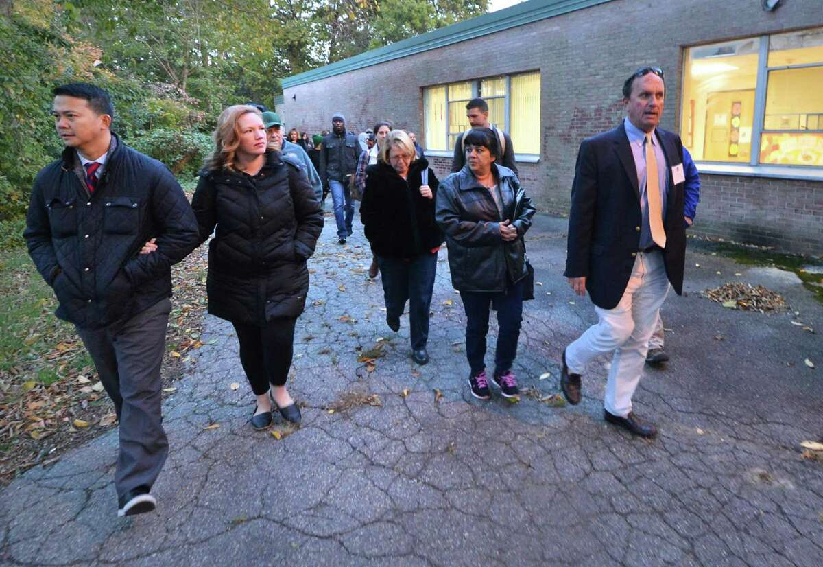 Mike Barbis, Chair of the School Facilities Committee guides a tour of the former Nathaniel Ely School site before a forum with the Board of Education to inform the public on the next steps in the development of its plans, including the possibility of a new building for Columbus Magnet School and a new neighborhood school in the former, renovated building, on Wednesday October 26, 2016 in Norwalk Conn.