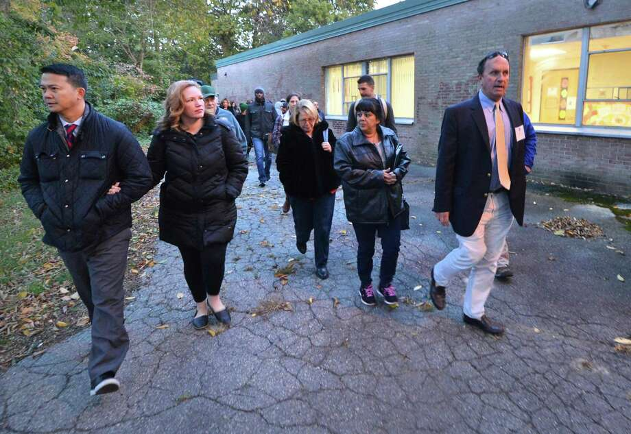 Mike Barbis, Chair of the School Facilities Committee guides a tour of the former Nathaniel Ely School site before a forum with the Board of Education to inform the public on the next steps in the development of its plans, including the possibility of a new building for Columbus Magnet School  and a new neighborhood school in the former, renovated building, on Wednesday October 26, 2016 in Norwalk Conn. Photo: Alex Von Kleydorff / Hearst Connecticut Media / Connecticut Post