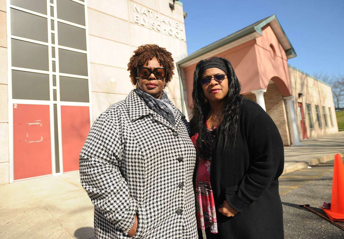 Community advocate and fellow Roodner Court resident Deidra Davis, left, and Norwalk Board of Education member Shirley Mosby outside the former Nathaniel Ely School in Norwalk, Conn. on Wednesday, April 13, 2016. There is a proposal to open three new schools in the city to deal with overcrowding, including Nathaniel Ely which is adjacent to the Roodner Court public housing complex.