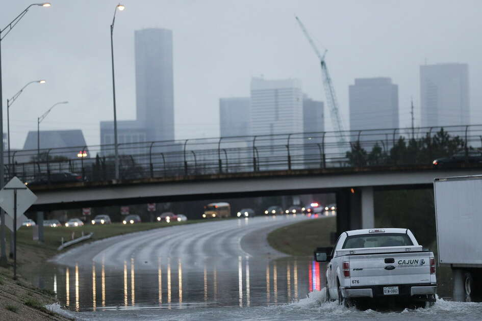 A truck leaves opposite traffic after having to turn around from a flooded 288 freeway on Wednesday, Jan. 18, 2017, in Houston.