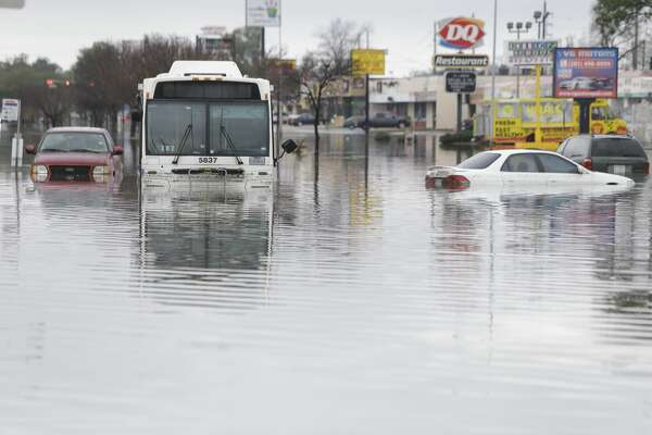 A Metro bus and other vehicles are shown stranded on the flooded street along West Bellfort at 59, Wednesday, Feb. 18, 2017. ( Melissa Phillip/ Houston Chronicle)