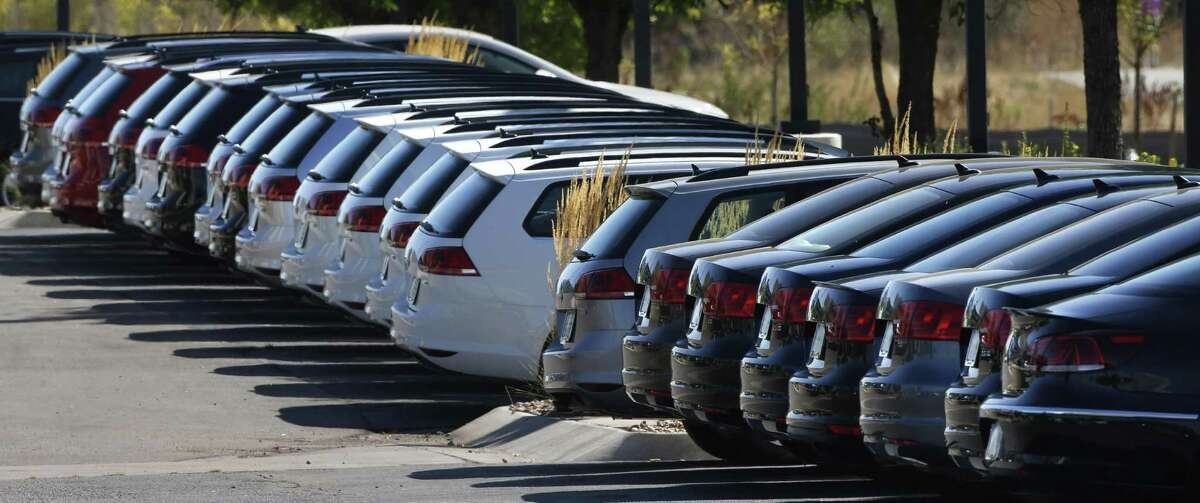 Volkswagen cars for sale are on display on the lot of a VW dealership in Boulder, Colo., Thursday, Sept. 24, 2015. Volkswagen is reeling days after it became public that the German company, which is the world's top-selling carmaker, had rigged diesel emissions to pass U.S. tests.
