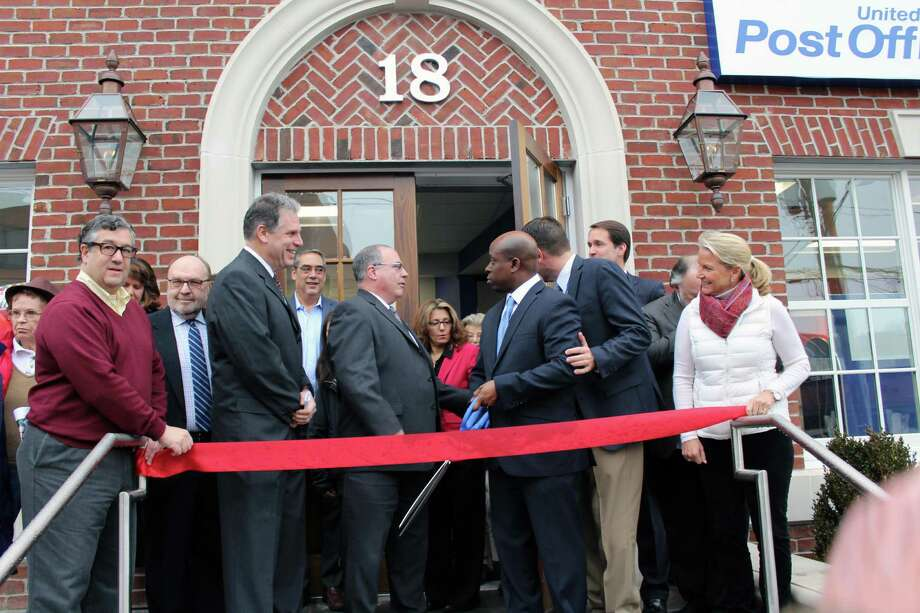 Those involved in bringing the new Post Office, including First Selectman Robert Mallozzi III, U.S. Rep. Jim Himes, CT-4, Executive Director of the Chamber of Commerce Tucker Murphy and Post Office Operations Manager Kevin Hogan, cut the ribbon on Jan. 17, 2017 in New Canaan, Conn. Photo: Justin Papp / Hearst Connecticut Media / New Canaan News