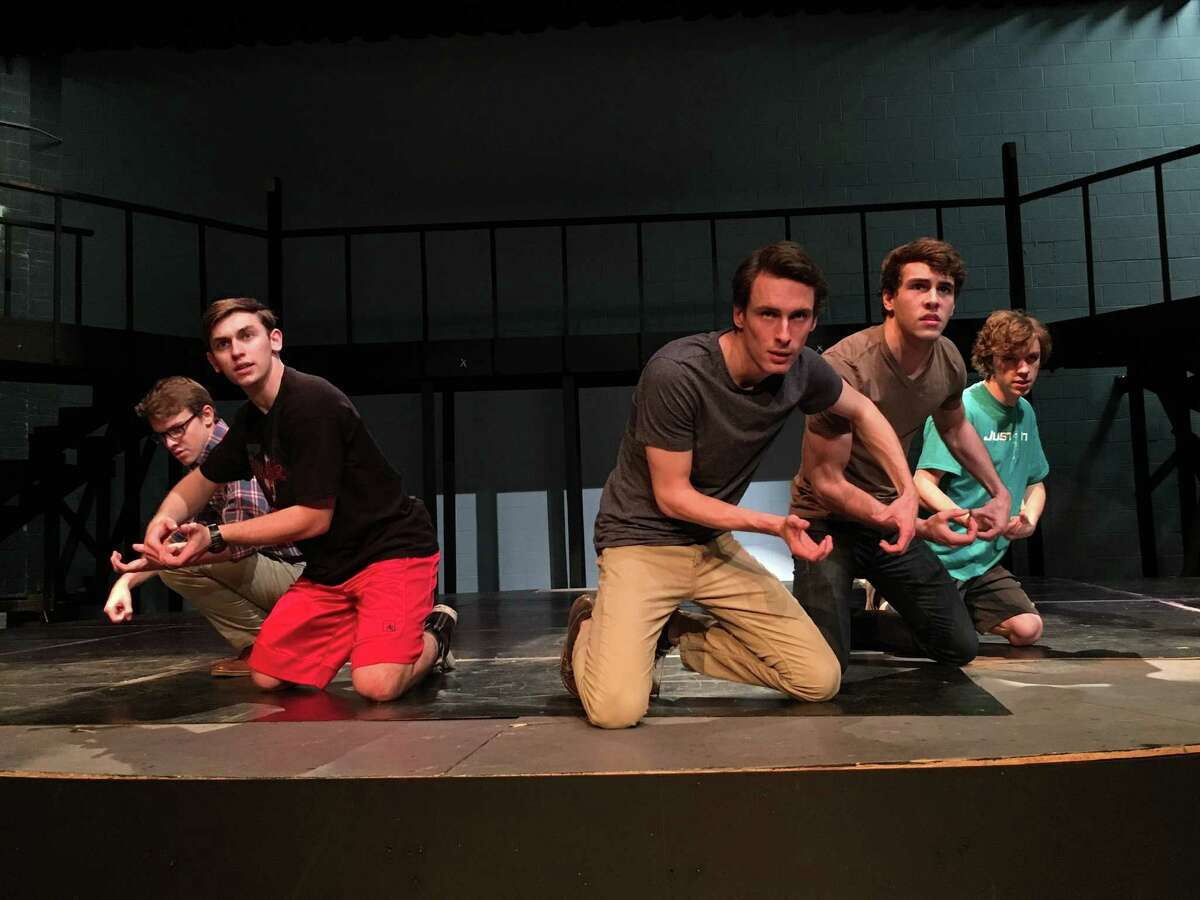 """Alex Rudd as Jean Valjean, third of the left, joins Max Morgan, left, Jacob Goodin, Kyle Dickens and Tyler Pittman in rehearsing a scene from Friendswood High School's production of """"Les Misérables School Edition."""""""