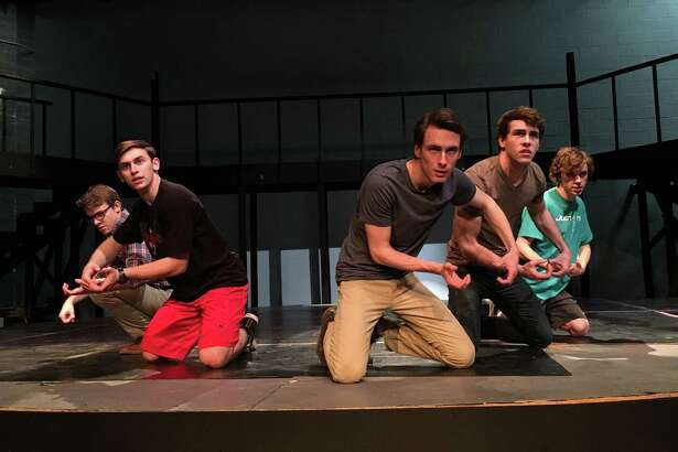"Alex Rudd as Jean Valjean, third of the left, joins Max Morgan, left, Jacob Goodin, Kyle Dickens and Tyler Pittman in rehearsing a scene from Friendswood High School's production of ""Les Misérables School Edition."""