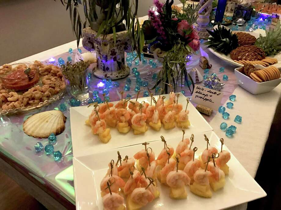 If you booze, you must serve food. At a recent, Atlantis-themed cocktail party at my house, canape offerings were heavy on seafood. Photo: Emily Spicer / San Antonio Express-News
