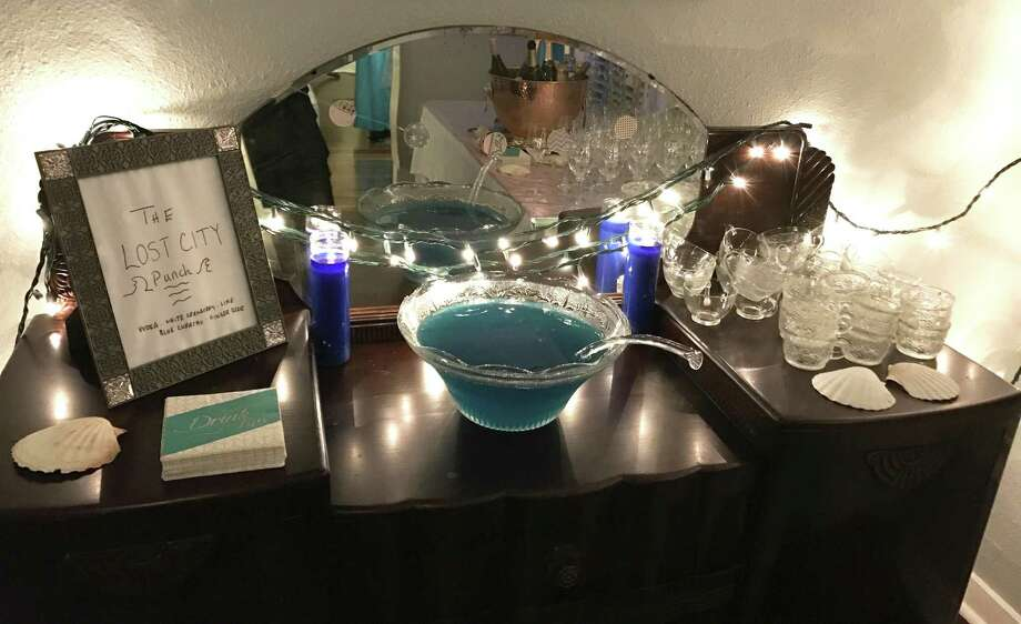Make a big strong punch to welcome guests when they arrive. And label it, so they know what they're about to imbibe. At a recent Atlantis-themed cocktail party at my house, a bowl of blue martinis (renamed Lost City Punch for the occasion) did nicely. Photo: Emily Spicer / San Antonio Express-News