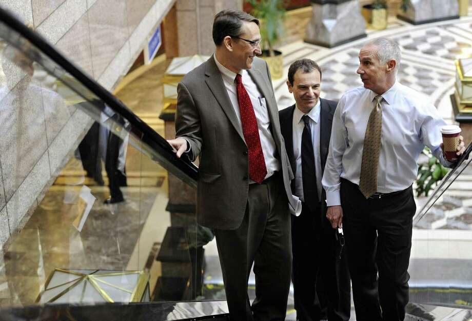 In a file photo, Connecticut's Office of Policy & Management Secretary Benjamin Barnes, left, arrived with OPM's Gian Carl Casa, center, and Gov. Dannel P. Malloy's then-chief chief of staff Mark Ojakian in 2013. Casa is now the president of the umbrella group of social-service agencies that on Wednesday offered ways for the state to save money. Photo: Jessica Hill / Associated Press / FR125654 AP