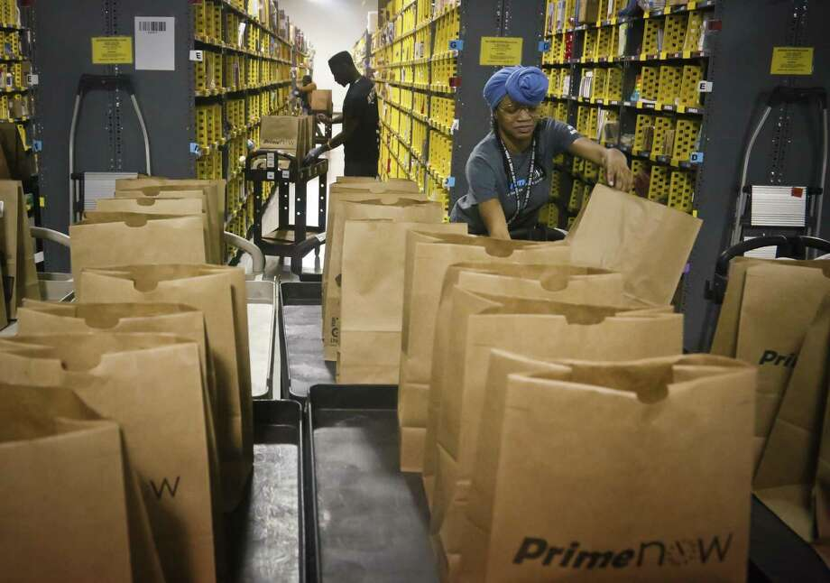 A series of blue-chip companies, among them Amazon, have all announced plans in recent weeks to hire and invest in the United States, although some highly promoted announcements were essentially recycled versions of previous news releases. Photo: Bebeto Matthews /Associated Press / Copyright 2016 The Associated Press. All rights reserved.
