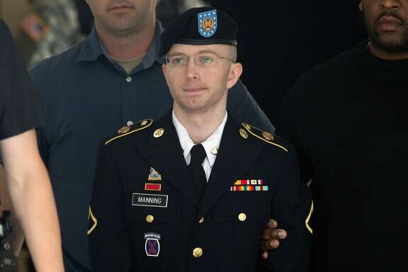 (FILES) This file photo taken on July 30, 2013 shows US Army Private First Class Bradley Manning leaving a military court facility after hearing his verdict in the trial at Fort Meade, Maryland. US President Barack Obama commuted the sentence of Manning a transgender woman now known as Chelsea Manning, who is serving 35 years behind bars for leaking classified US documents, the White House said January 17, 2017.  / AFP PHOTO / SAUL LOEBSAUL LOEB/AFP/Getty Images