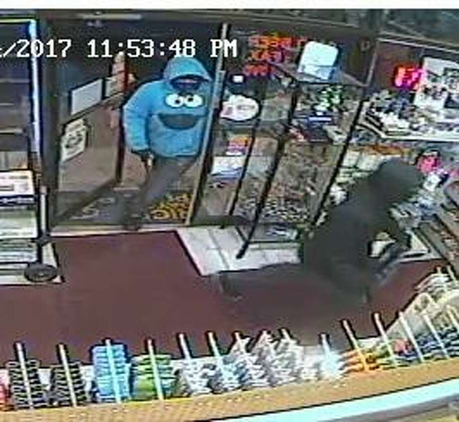 Police have released surveillance footage from cameras at Rainbow Variety in Norwalk, which was robbed this month. Photo: Contributed Photo / Norwalk Police Department