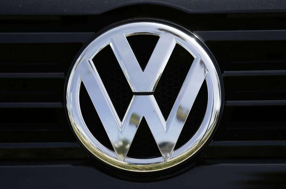 A Volkswagen logo is seen on a car offered for sale in California. An attorney for the automaker said Wednesday that close to 67,000 of the roughly 470,000 Volkswagen and Audi 2-liter diesel models sold in the United States with emissions-cheating software have been returned to dealers for buybacks or lease terminations. Photo: Damian Dovarganes, Associated Press
