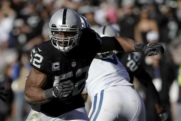 Oakland Raiders defensive end Khalil Mack (52) against the Indianapolis Colts during an NFL football game in Oakland, Calif., Saturday, Dec. 24, 2016. (AP Photo/Marcio Jose Sanchez)