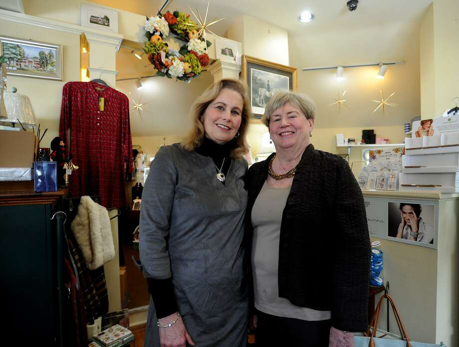 Partners Patty Bryan, left, and Betsy Ehrsam, both of Trumbull, are closing up shop at their Flourishes gift shop after more than twenty years in business at 5665 Main Street in Trumbull, Conn. on Tuesday, January 10, 2016. The store is conducting a going out of business sale. Photo: Brian A. Pounds / Hearst Connecticut Media / Connecticut Post