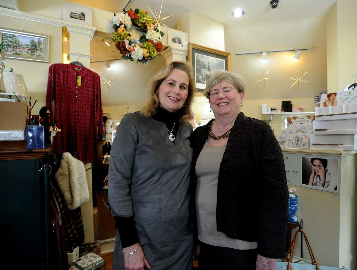 Partners Patty Bryan, left, and Betsy Ehrsam, both of Trumbull, are closing up shop at their Flourishes gift shop after more than twenty years in business at 5665 Main Street in Trumbull, Conn. on Tuesday, January 10, 2016. The store is conducting a going out of business sale.