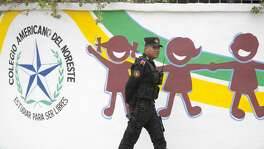 A police officer walks outside a high school after a student opened fire on his classmates, in Monterrey, Mexico, on January 18, 2017. A high school student shot his teammates at a college in Monterrey, an industrial city in northeastern Mexico, in an unprecedented event that left five people injured, including the assailant who attempted suicide, authorities in the state of Nuevo Leon reported. / AFP / Julio Cesar AGUILAR        (Photo credit should read JULIO CESAR AGUILAR/AFP/Getty Images)
