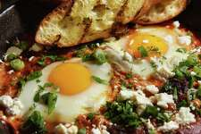 Shakshuka, spicy house-made lamb sausage, farm eggs, heirloom tomatoes and feta,  at the Bartlett House Thursday Jan. 12, 2017 in Ghent, NY.  (John Carl D'Annibale / Times Union)