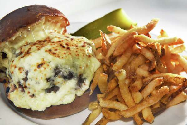 The Bartlett House Burger, fries and  garlic aioli at the Bartlett House Thursday Jan. 12, 2017 in Ghent, NY.  (John Carl D'Annibale / Times Union)