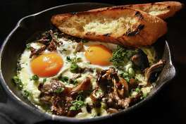 Shirred eggs, locally foraged mushrooms, leeks, gruyere, cream Dutch Baby, apples and cinnamon at the Bartlett House Thursday Jan. 12, 2017 in Ghent, NY.  (John Carl D'Annibale / Times Union)