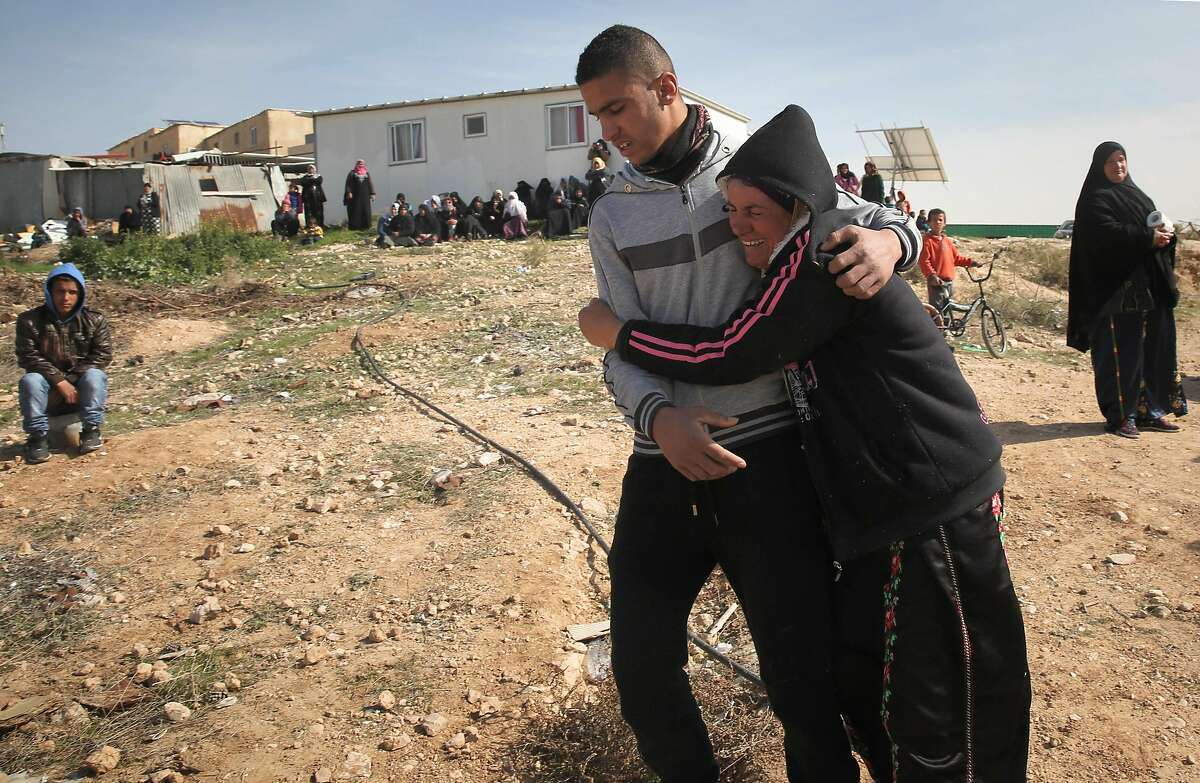 Bedouins cry following the destruction of houses on January 18, 2017 in the Bedouin village of Umm al-Hiran, which is not recognized by the Israeli government, near the southern city of Beersheba, in the Negev desert. An Israeli policeman was killed while taking part in an operation to demolish homes in the Bedouin village, with authorities claiming he was targeted in a car-ramming attack. The driver was earlier reported shot dead by police as residents disputed the police version of events, saying the driver was heading to the scene to talk with authorities in an attempt to halt the demolitions. / AFP PHOTO / MENAHEM KAHANAMENAHEM KAHANA/AFP/Getty Images