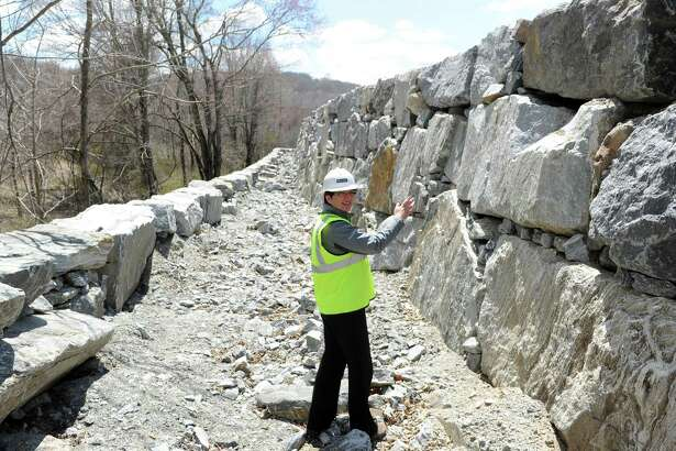 Kathy Ekstrom, development manager for Haynes, shows off the Quarry Walk that will surround Oxford's mixed-use development that will include 150 homes alongside a Market 32 supermarket and other retail and office space, in 2015, at the site off of Route 67.