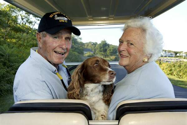 KENNEBUNKPORT, ME - AUGUST 25:   Former President George H. W. Bush and Barbara Bush in the back of a golf cart with their dog Millie at their home at Walker's Point in Kennebunkport, Maine, Aug. 25, 2004 (Photo by David Hume Kennerly/Getty Images)