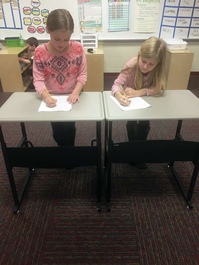 Pictured working at the standing desks is Cambrie Mitchell and Mikayla Kildow, and in the wobble seat is Addison Putman. Thank you to Bad Axe Wal-Mart for offering these children tools to promote their future success. (Submitted photo)