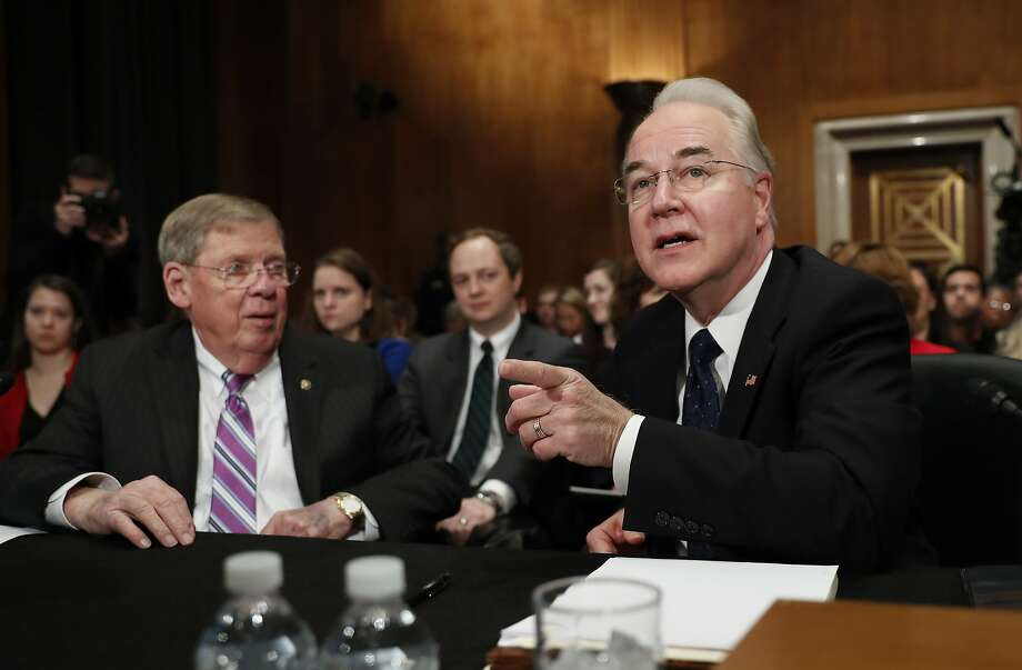 Democrats pepper Georgia Rep. Tom Price (right) with questions about his extensive stock portfolio. Photo: Carolyn Kaster, Associated Press