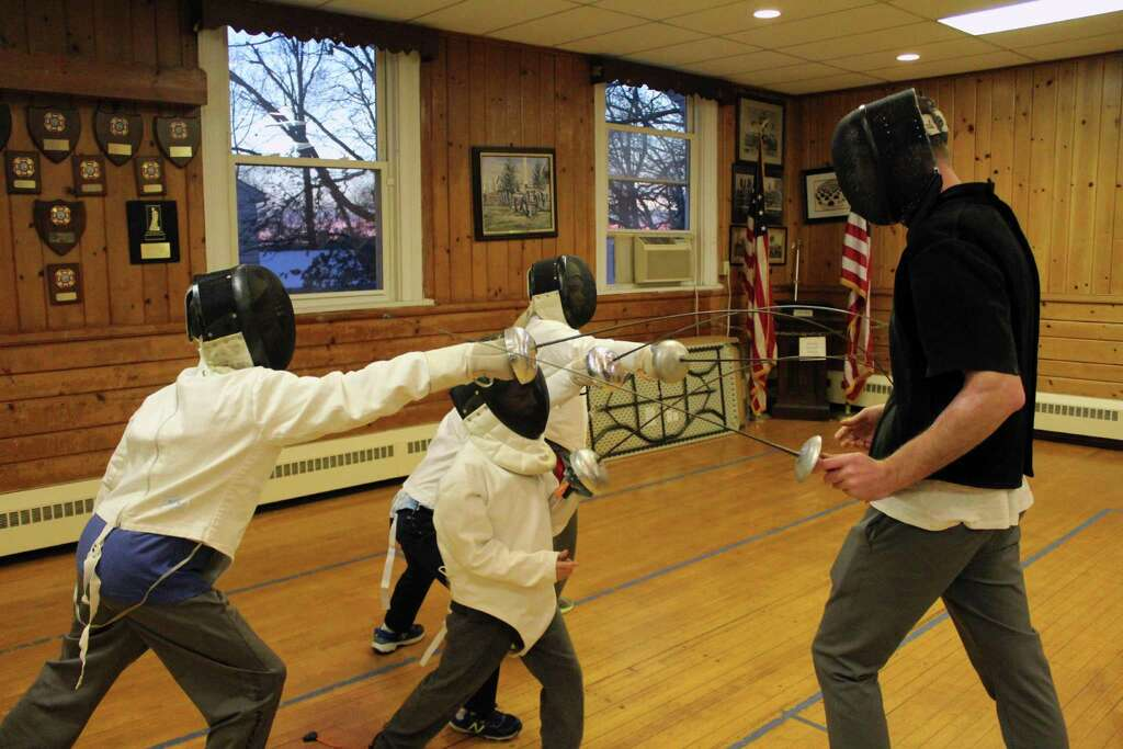 Fencers lunge at their coach, Dima Chumak, at the Darien Fencing Club on Jan. 15, 2017 in Darien, Conn. Photo: Justin Papp / Hearst Connecticut Media / Darien News