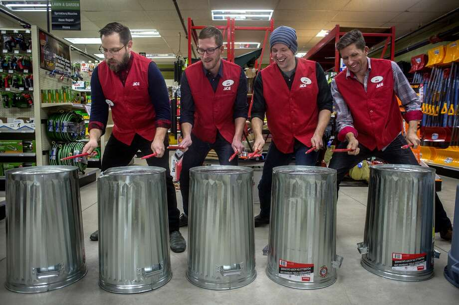 "TorQ Percussion Quartet members from left: Dan Morphy, Jamie Drake, Adam Campbell and Richard Burrows on metal trash cans during a performance at Ace Hardware and Sports Wednesday afternoon. ""We're a percussion quartet,"" Campbell said to listeners. ""Which means we make our living hitting stuff."" The quartet used musical instruments as well as wind chimes, metal trash cans and pieces of wood to make music. Photo: Brittney Lohmiller/Midland Daily News/Brittney Lohmiller"