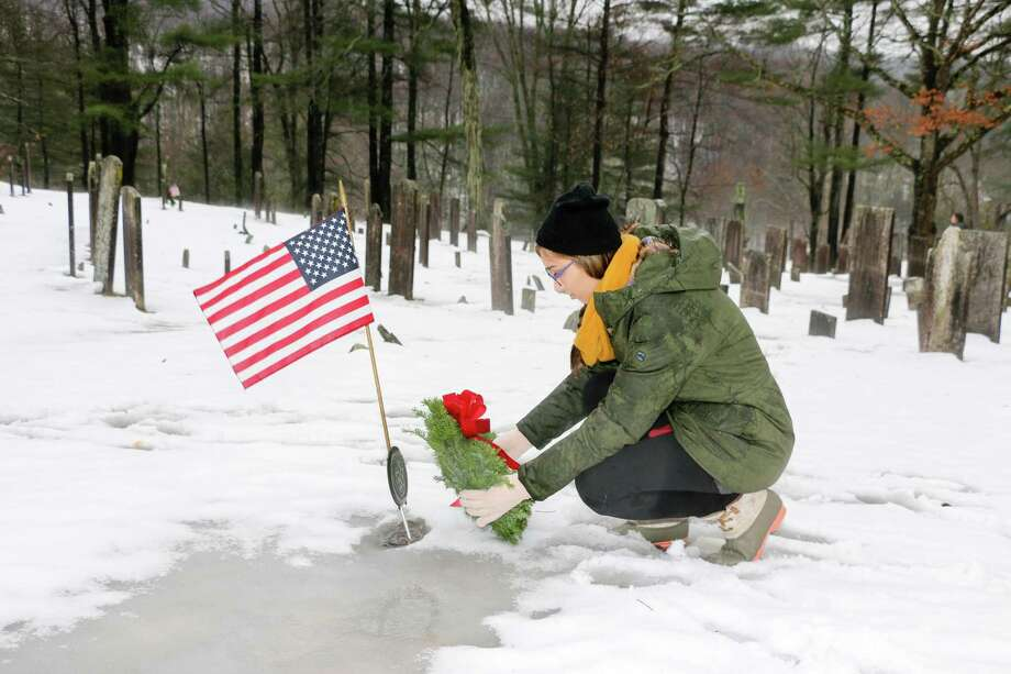Glenholme students in Washington and American veterans recently joined the representatives from the Judea Chapter of the Daughters of the American Revolution in the Wreaths Across America annual ceremony to honor of American veterans resting in the Judea Cemetery of Washington. Glenholme student, Cassidy Seaver, place a wreath at a veterans gravestone as part of the special event. Photo: Contributed Photo / Contributed Photo / The News-Times Contributed