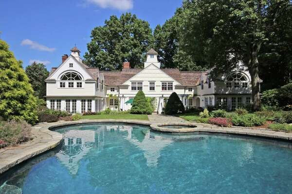 The yellow colonial house at 445 Old Academy Road was built in 1948 and it is perfectly placed on a private arboretum that contains tall trees, abundant perennial plantings, mature specimen shrubbery, and a heated Gunite in-ground pool and spa.