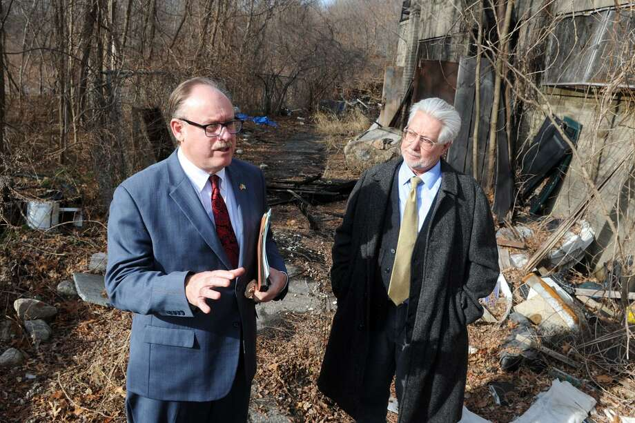 Kurt Spalding, Northeast Regional Administrator for the Environmental Protection Agency, speaks at the site of the old Raybestos Brakettes softball stadium on Frog Pond Ln., in Stratford, Conn. Jan 11, 2016. The EPA plans a $90-million cleanup of the property. Spalding is seen here with Jim Murphy, Team Leader for Government and Community Relations for the EPA. Photo: Ned Gerard / Hearst Connecticut Media / Connecticut Post