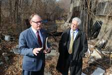 Kurt Spalding, Northeast Regional Administrator for the Environmental Protection Agency, speaks at the site of the old Raybestos Brakettes softball stadium on Frog Pond Ln., in Stratford, Conn. Jan 11, 2016. The EPA plans a $90-million cleanup of the property. Spalding is seen here with Jim Murphy, Team Leader for Government and Community Relations for the EPA.