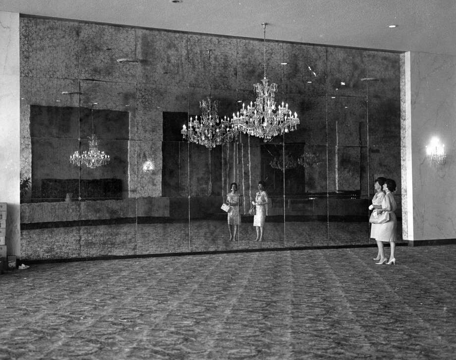 """Houston Post, May 1965: The elaborate chandelier sets off the huge antique mirror and marble walls in the lobby of the new Sharpstown Theatre. According to David Welling's """"Cinema Houston,"""" the Sharpstown Theatre (known mainly as the Gaylynn) was one of the """"last of the large-scale Houston movie houses built before the multiplex era."""" The theater, located near Sharpstown Mall in southwest Houston, featured three 56-inch-wide chandeliers and a 50-by-175-foot lobby. The Gaylynn Terrace, a second theater at the site, opened in 1968. Welling's book notes that the theater hosted several special events over the years, including a live appearance by Johnny Cash and the premiere of such films as """"Urban Cowboy"""" and """"Beneath the Valley of the Ultra-Vixens."""" Competition from nearby multiplexes hurt the Gaylynn and contributed to its closure in 1988. Welling notes that a month before the theater premiered, multi-screen theaters opened at Meyerland, Gulfgate and Northline. Photo: Unknown, Houston Post"""