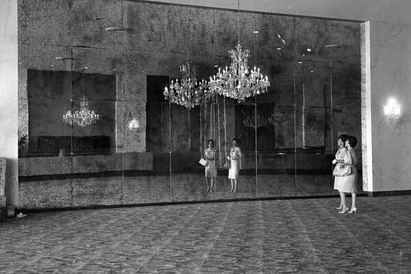 Houston Post, May 1965: The elaborate chandelier sets off the huge antique mirror and marble walls in the lobby of the new Sharpstown Theatre. 