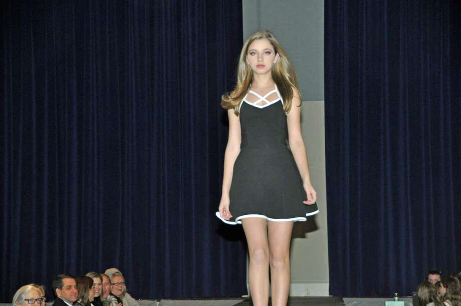 Stanwich School student Cullen Murphy takes part in the 2016 fashion show at the school to benefit Project Blessing. Some of the proceeds go to build a school in Rwanda. Photo: Contributed Photo