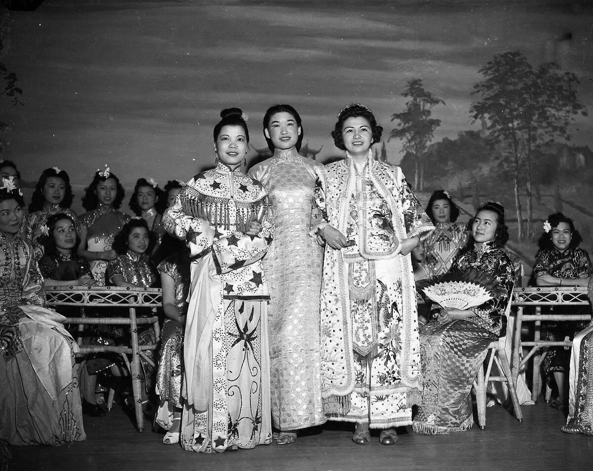 Historic Chinese fashions at the Chinatown Rice Bowl Party & Parade 1940. (L to R) Rose Lum in a costume from the Tang Dynasty. Doreen Feng (c) played the part of hostess, Miss Babette Lau (right)