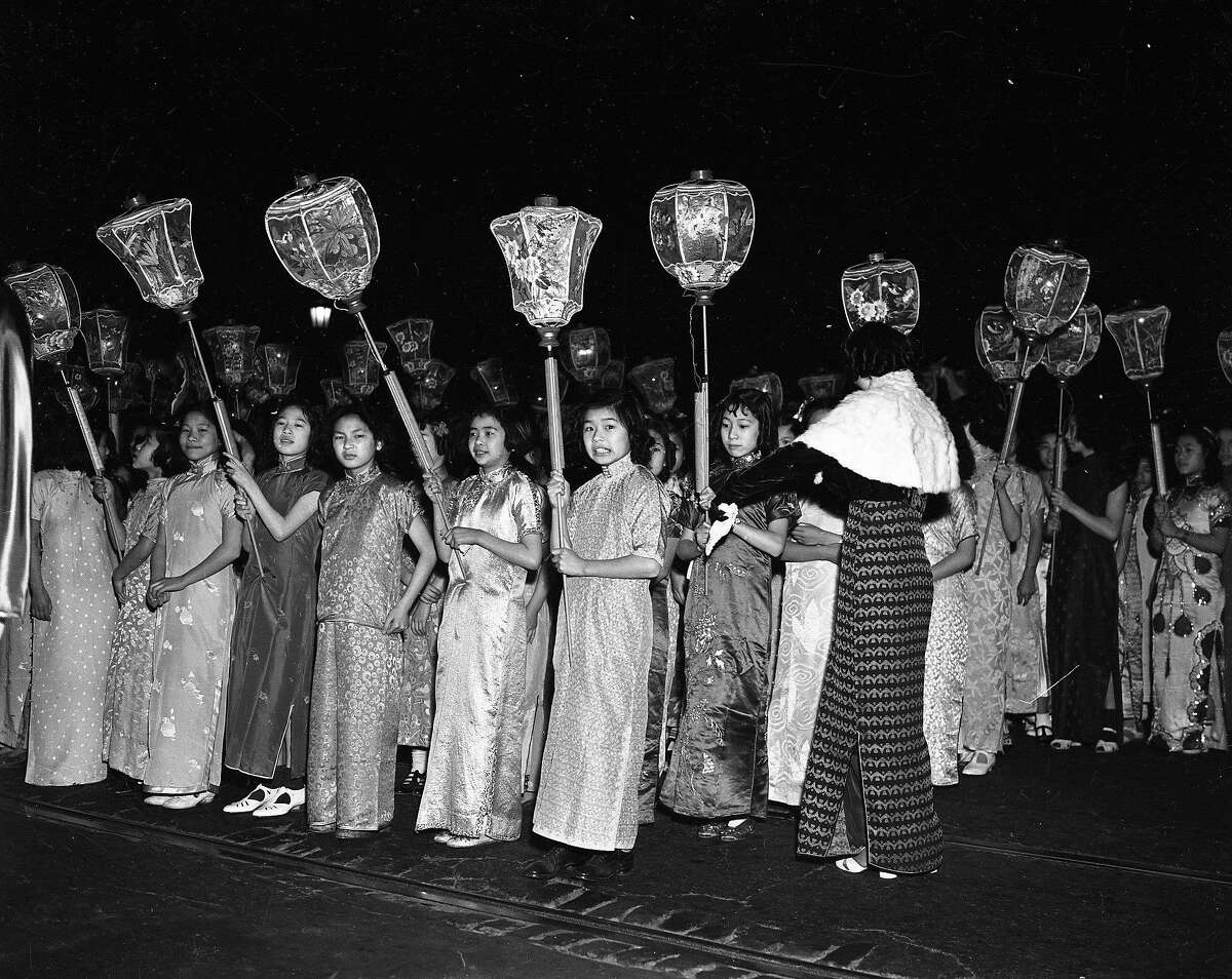 marchers with lanterns at the Chinatown Rice Bowl Party & Parade 1940